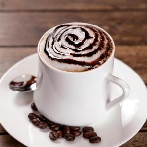 Yolá Whipped Yogurt Topping swirled into a Cafe mocha